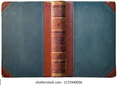 Old open book cover with embossed leather spine, cloth boards and abstract golden geometric decorations - circa 1909 - isolated on white
