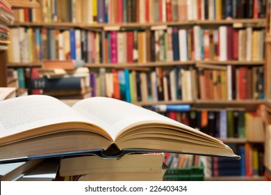 Old open book with library background