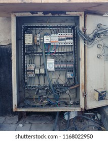 An old open electrical control panel box.