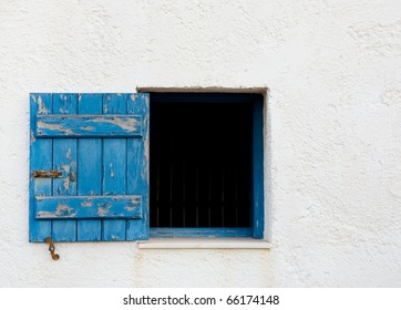 The old open window with blue shutters. Background. Texture.