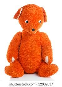 old orange  bear toy isolated on white