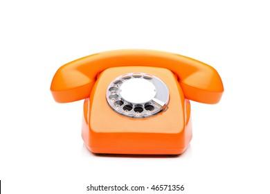 An old orange phone isolated on white background