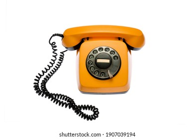 Old, orange rotary dial telephone, isolated on white background. - Shutterstock ID 1907039194