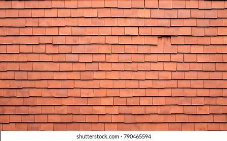 Old orange square tiles. Home roof, textured background with beautifully lined top view.