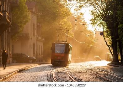 Old orange tram in backlight. Lviv (Lvov), Ukraine