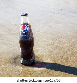 Old Orchard Beach, USA - 3rd Sept 2014: Illustrative editorial image of a bottle of Pepsi being kept cold in the sea. A popular carbonated soft drink produced by PepsiCo since 1893, and sold worldwide