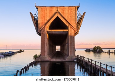 The old ore dock in the harbor at Marquette, Michigan, now in disuse, was used to unload railway ore cars into ships below. Shot near sunset.