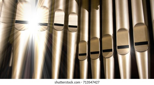 old organ pipes with a strong flash of light