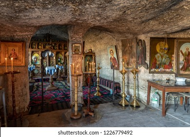 Old Orhei, Moldova - November 2018: Orthodox Church carved in rock mountain in Old Orhei region, Butuceni Village, now an important tourist attraction in Moldova