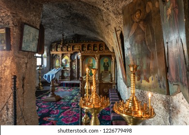 Old Orhei, Moldova - November 2018: Orthodox Church carved in rock mountain in Old Orhei region, Butuceni Village now an important tourist attraction in Moldova