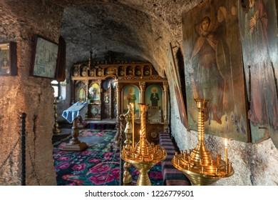 Old Orhei, Moldova - November 2018: Rock carved Orthodox Church in Old Orhei region, Butuceni Village