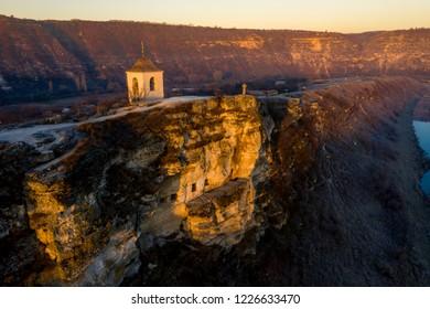 Old Orhei stone carved church at sunset Moldova Republic