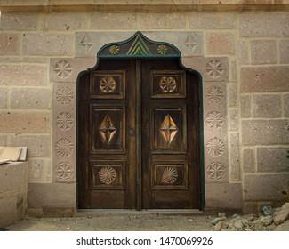 Old oriental door seen in Cavusin, Kapadokya, Turkey