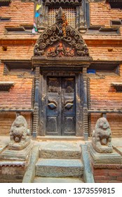 Old ornamented newari style door taken during a sunny afternoon in the historical center of Bhaktapur, Nepal