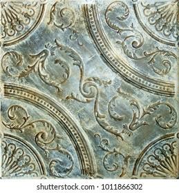 Old ornate metal ceiling tile