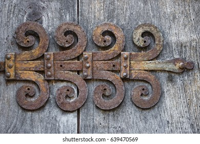 Old ornate rusty door hinge