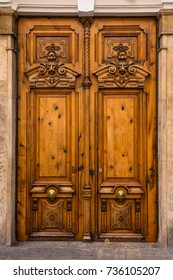 old ornate wooden door with beautiful carvings in Valencia, Spain