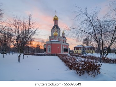 Old orthodox church on a cold winter evening at sunset. Trinity Church in Moscow in the manor Sviblovo