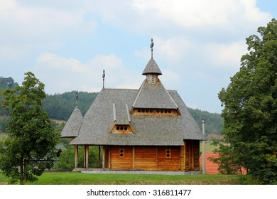 old orthodox wooden church on hill