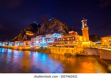 Old Ottoman houses evening colorful lights view by the Yesilirmak River in Amasya City. Amasya is populer tourist destination in anatolia Turkey. Amasya City, Turkey