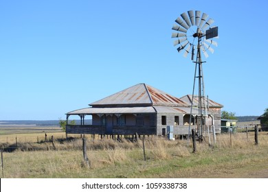 Old outback farmhouse with windmill, Back Plains, Queensland Australia