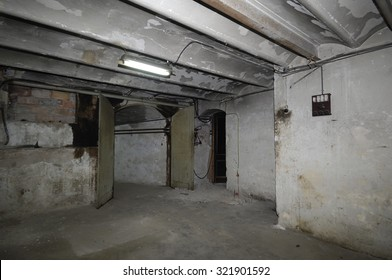 Old and outdated room in the basement of a house with electric installation