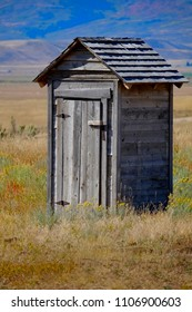Old outhouse in prairie ghost town countryside abandoned historical area