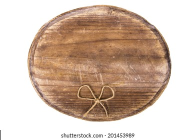 old oval wooden tablet and bow isolated on white background