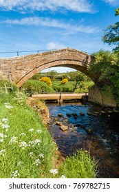 An old packhorese bridge over the river Esk in the North York Moors. Also known as Duck Bridge
