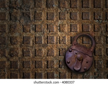 old padlock metallic sewer cover at the background