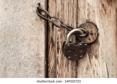 Old padlock on a chain