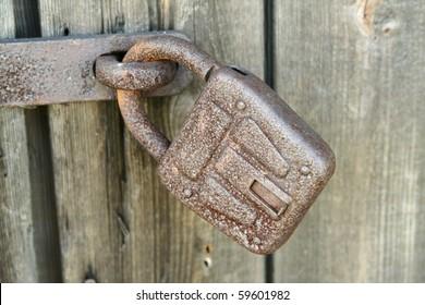 Old padlock on an old wooden door