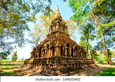Old pagoda with teak trees in Pa Sak temple, Chiang Rai Province.