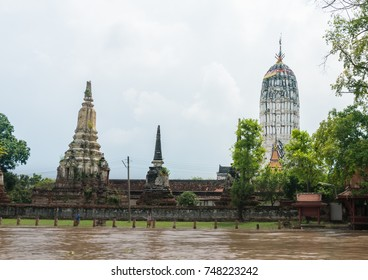 Old pagoda in the temple which near riverside and blue sky background. Blue sky and riverside ancient city on the bottom. Buddhism tower located near the river.