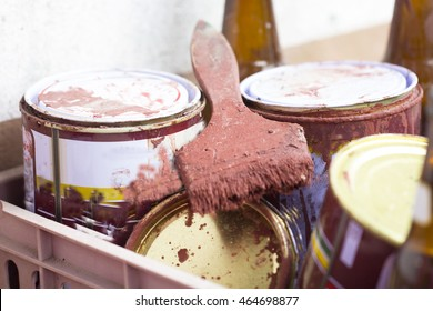 Old paint brush tool in the over the can.