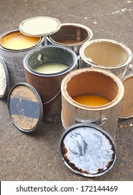 Old Paint in Messy, Rusty Cans Ready for Recycling