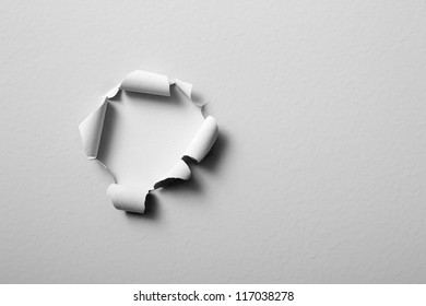 old paint peeling off the wall - round shaped hole