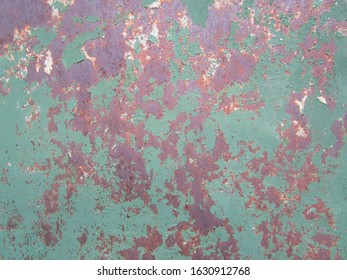 Old paint and rust on a metal surface