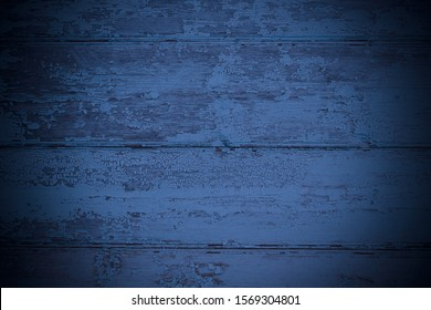 Old painted blue wooden boards. Horizontal view. Close-up. Background. Texture.