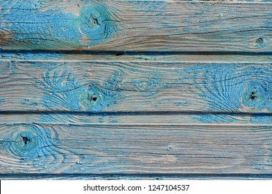 Old painted dilapidated wooden fence.