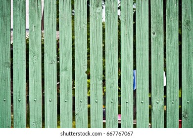 Old painted green wooden planks, rustic texture, background