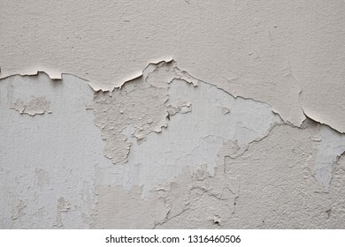 old painted wall, white color wall surface texture, peeling dry color
