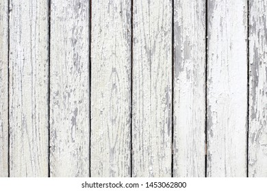 Old painted wood surface as a background in bright sunlight.