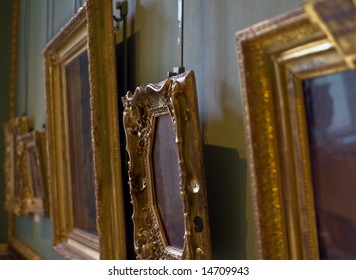 Old paintings in golden frames