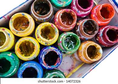 old paints in open jars closeup