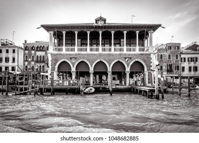 Old palace on Grand Canal, Venice, Italy. Historical architecture of Venice in black and white. Ancient house on the water in Venice. Traditional view of a street of Venice. Vintage retro style photo.