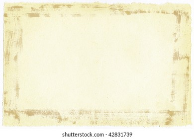 Old paper background with ragged edges with grunge frame