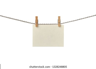 Old paper blank card hanging on the clothesline isolated on white background