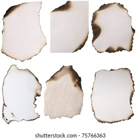old paper with burnt edges over white