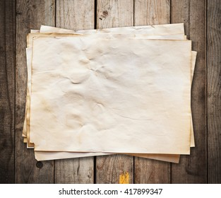 old paper on wood background and texture